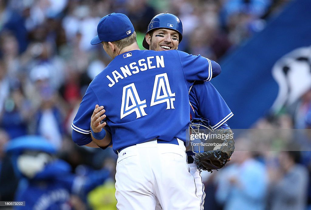 <a gi-track='captionPersonalityLinkClicked' href=/galleries/search?phrase=J.P.+Arencibia&family=editorial&specificpeople=4959430 ng-click='$event.stopPropagation()'>J.P. Arencibia</a> #9 of the Toronto Blue Jays celebrates their victory with teammate <a gi-track='captionPersonalityLinkClicked' href=/galleries/search?phrase=Casey+Janssen&family=editorial&specificpeople=598479 ng-click='$event.stopPropagation()'>Casey Janssen</a> #44 during MLB game action against the Baltimore Orioles on September 14, 2013 at Rogers Centre in Toronto, Ontario, Canada.