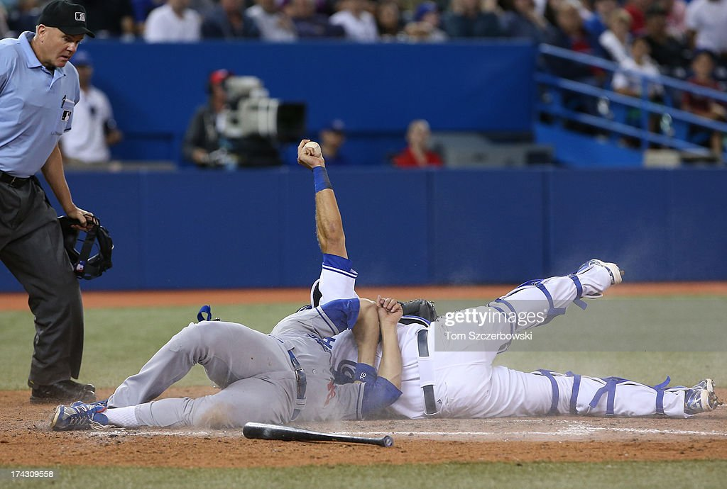 J.P. Arencibia #9 of the Toronto Blue Jays tags out Andre Ethier #16 of the Los Angeles Dodgers in the seventh inning on July 23, 2013 at Rogers Centre in Toronto, Ontario, Canada.
