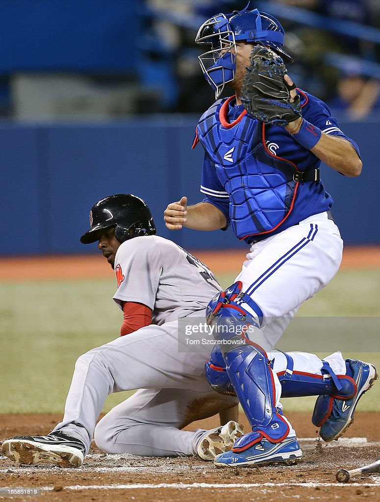 J.P. Arencibia #9 of the Toronto Blue Jays tags out Pedro Ciriaco #23 of the Boston Red Sox in the third inning during MLB game action on April 6, 2013 at Rogers Centre in Toronto, Ontario, Canada.