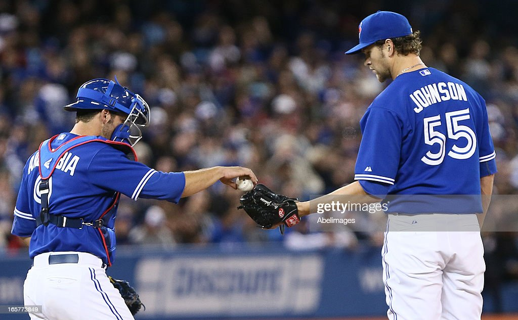 J.P. Arencibia #9 talks to Josh Johnson #55 of the Toronto Blue Jays during a break against the Boston Red Sox in the 5th inning during MLB action at the Rogers Centre April 5, 2013 in Toronto, Ontario, Canada.