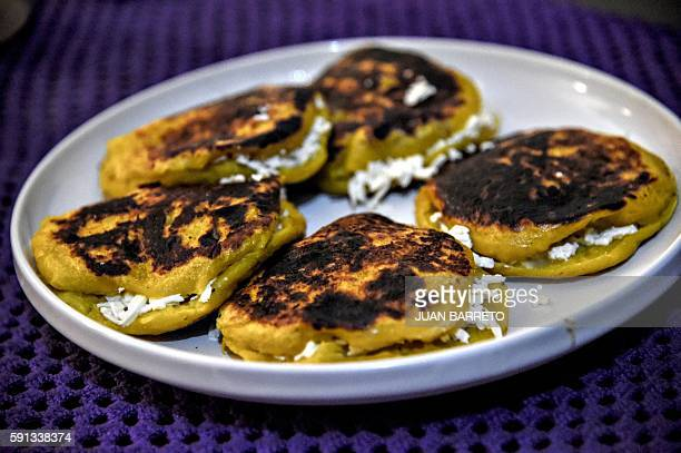 'Arepas' made with plantains in Caracas on 16 August 2016 Pumpkin and beetroot arepas plantain peels pretending to be shredded meat Venezuelans are...