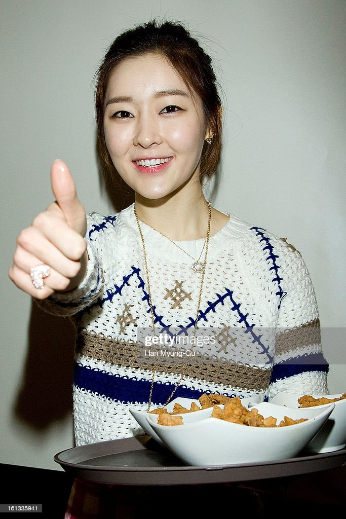 Areum of South Korean girl group T-ara poses for media during as holds Chicken pieces at the Core Contents Media Artists New Year's Day Charity Event at Gibalhan Chicken Store on February 9, 2013 in Bucheon, South Korea.