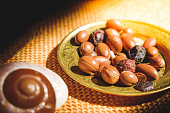 Argan nuts seeds on plate - Argan is an antioxidant used to produce oil for the skin .
