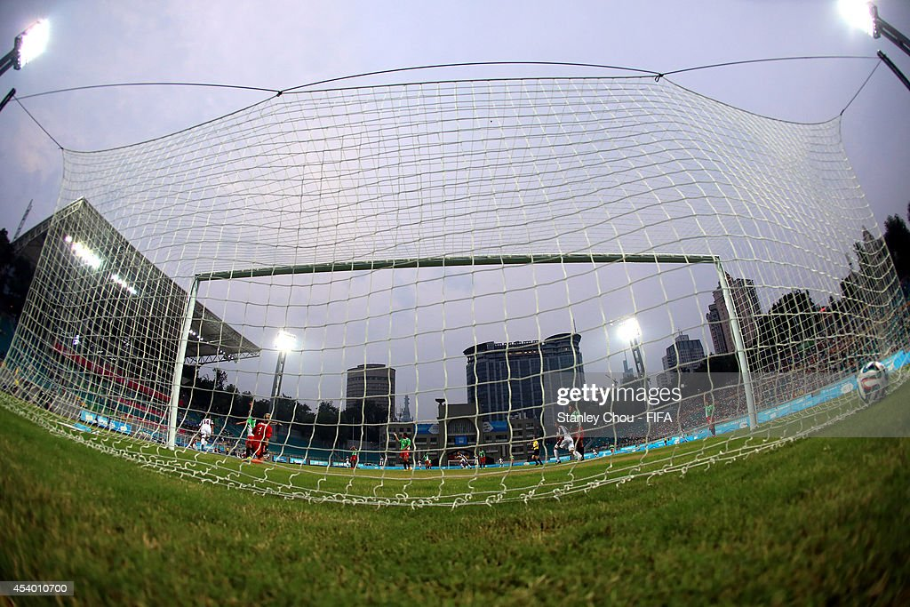 Argelis Campos of Venezuela scores the 1st goal against Mexico during the 2014 FIFA Girls Summer Youth Olympic Football Tournament Semi Final match between Venezuela and Mexico at Wutaishan Stadium on August 23, 2014 in Nanjing, China.