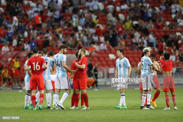 Argentina and Singapore exchange jerseys at the end of the international friendly match between Argentina and Singapore at National Stadium on June...