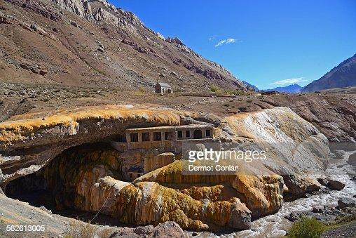 Argentina, Andes, Mendoza, Aconcagua Provincial Park, Inca Bridge, View old building under natural bridge in valley