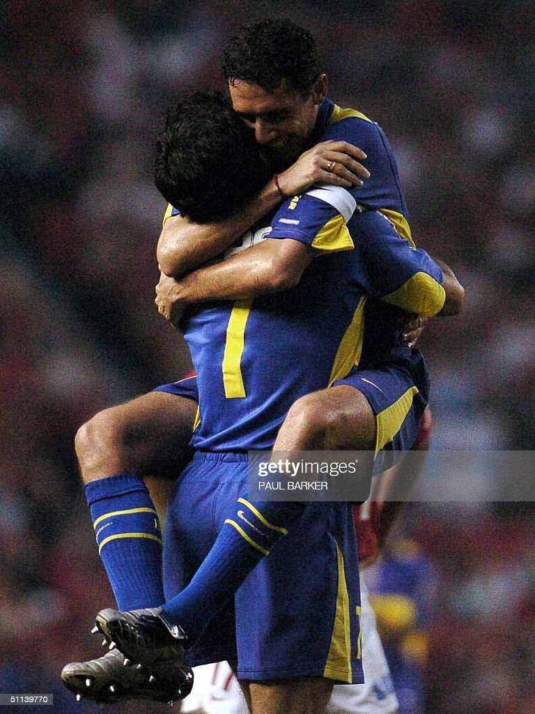 Argentina' Boca Juniors Diego Cagna celebrates his teams fourth goal against Urawa Red Diamonds of Japan with Ariel Carreno 03 August 2004 during...
