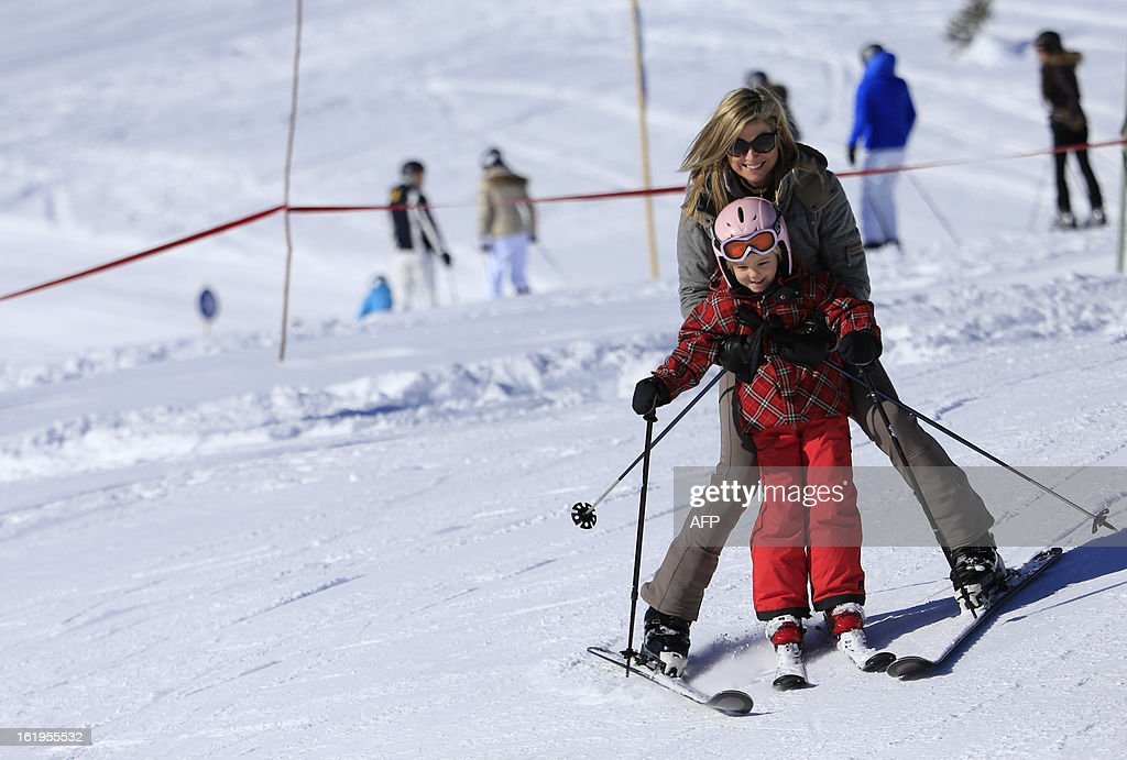 Argentina born Princess Maxima (top) skis with her daugther Princess Ariane as part of a photocall session during the Royal Dutch Family's ski holidays in Lech am Arlberg, western Austria, on February 18, 2013.