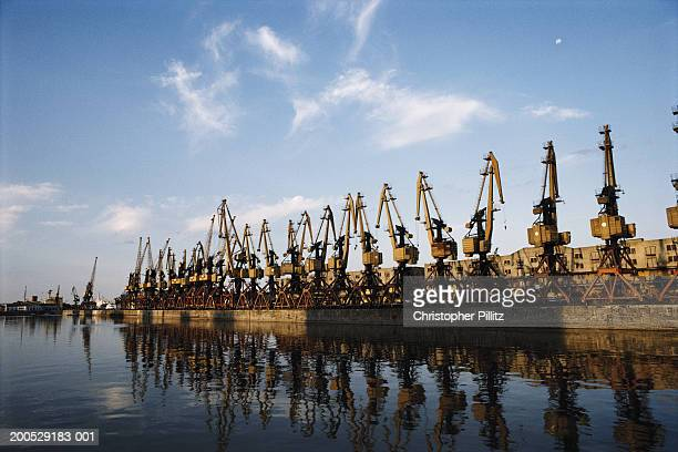 Argentina, Buenos Aires, abandoned cranes on dockside
