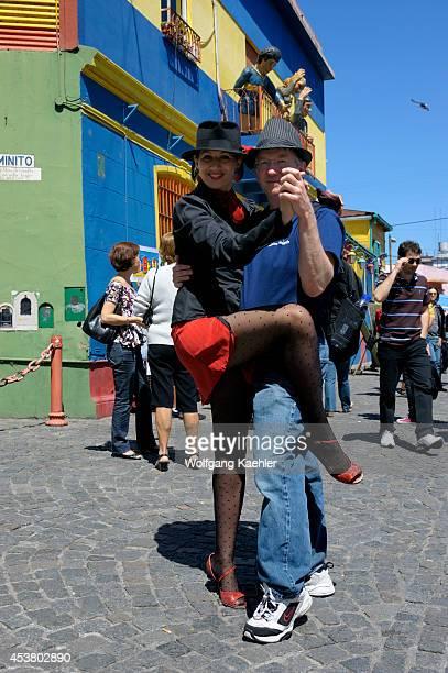 Argentina Buenos Aires La Boca Tango Dancer Posing With Tourist