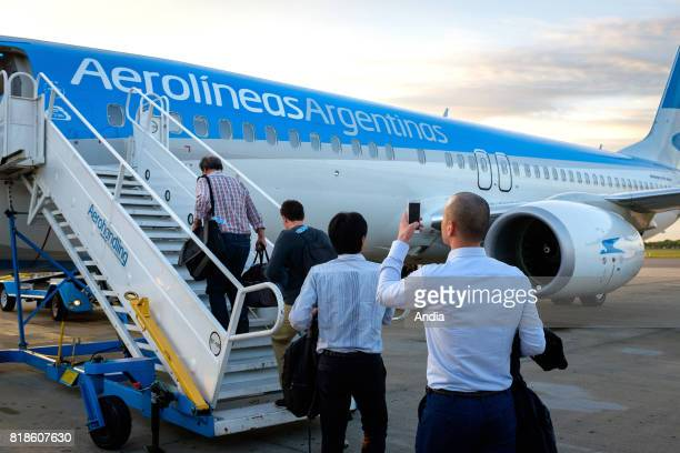 Argentina Buenos Aires Ministro Pistarini International Airport Passengers boarding a Boeing 737 of the national airline Aerolineas Argentinas flying...