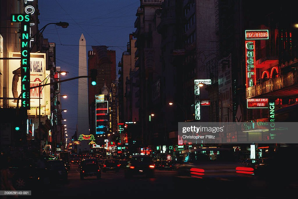 Argentina, Buenos Aires, neon signs in city street, night