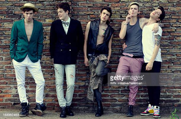 Argentina, Buenos Aires, Portrait of five young men posing in street