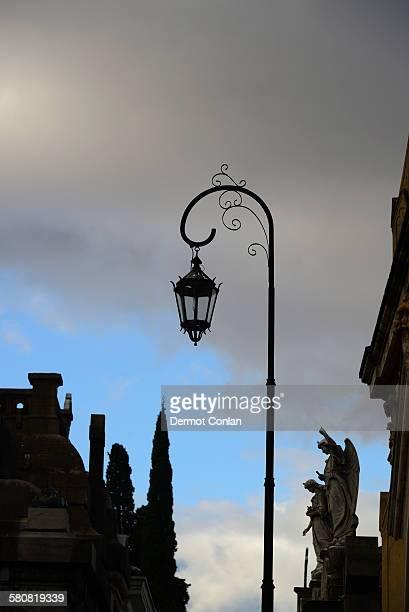 Argentina, Buenos Aires, Recoleta Cemetery sculpture and antique street light