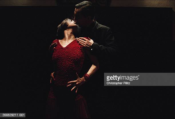 Argentina, Buenos Aires, tango dancers performing in darkness