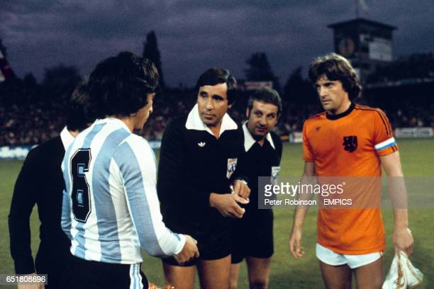 Argentina captain Daniel Passarella and Holland captain Ruud Krol listen to the referee at the coin toss
