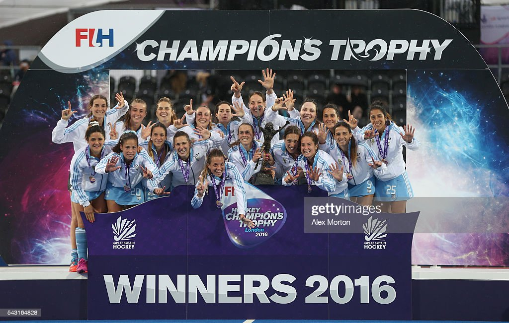 Argentina celebrate on the stage with the tophy during the FIH Women's Hockey Champions Trophy 2016 final match between Netherlands and Argentina at Queen Elizabeth Olympic Park on June 26, 2016 in London, England.