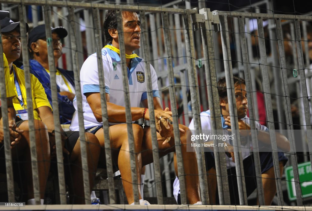 Argentina coach Hector Petrasso watches from the stands after being sent there by the referee during the FIFA Beach Soccer World Cup Tahiti 2013 Quarter Final match between Argentina and Tahiti at the Tahua To'ata Stadium on September 25, 2013 in Papeete, French Polynesia.