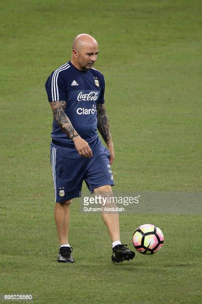 Argentina coach Jorge Sampaoli controls the ball during an Argentina training session at National Stadium on June 12 2017 in Singapore Argentina is...