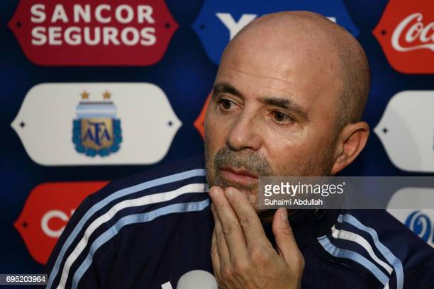 Argentina coach Jorge Sampaoli listens to a question from a member of media during a prematch press conference at National Stadium on June 11 2017 in...