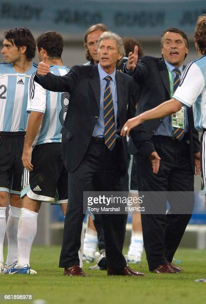 Argentina coach Jose Pekerman gives instructions to his players before the start of extra time