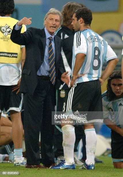 Argentina coach Jose Pekerman gives instructions to Javier Mascherano before the start of extra time