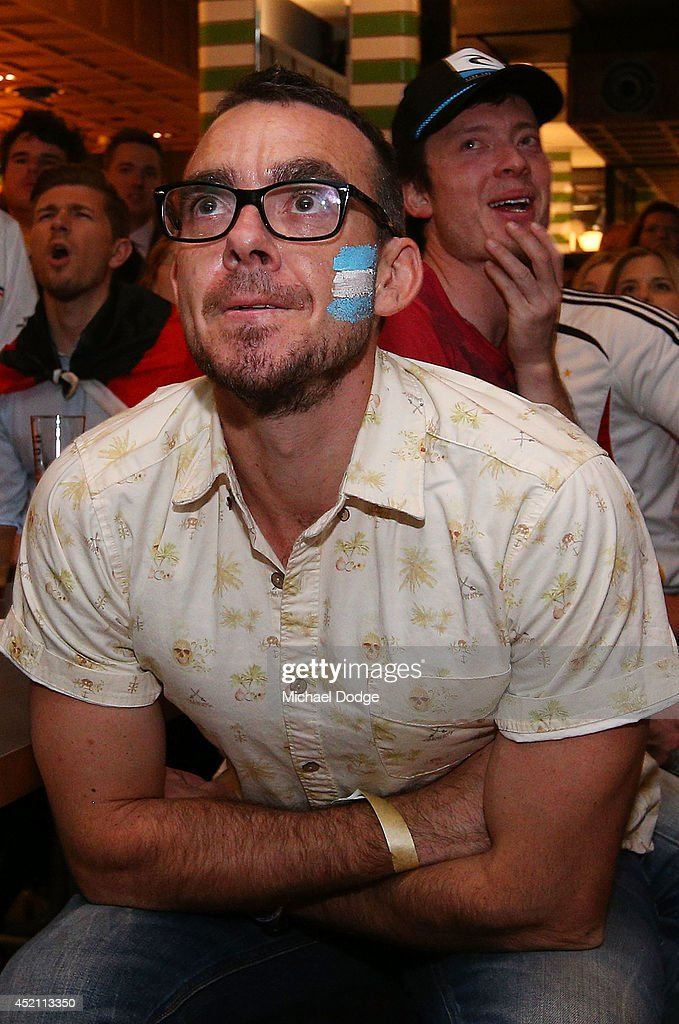 Argentina fans at Hophaus react after a missed chance for goal while watching the 2014 FIFA World Cup Final match between Germany and Argentina on July 14, 2014 in Melbourne, Australia.