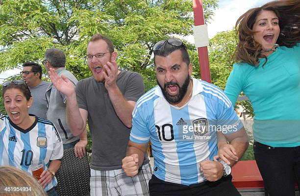 Argentina fans celebrate at the Netherlands vs Argentina World Cup semifinal match viewing party at the Red Fox English Pub on July 9 2014 in Royal...