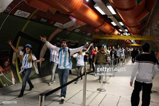 Argentina fans celebrate in a subway station in São Paulo after their team won the semifinal World Cup game between Argentina and the Netherlands in...