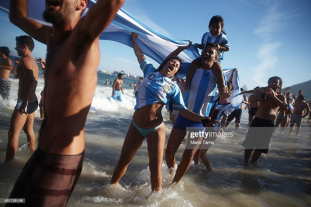 Argentina fans celebrate their victory over Belgium in the 2014 FIFA World Cup on Copacabana Beach on July 5, 2014 in Rio de Janeiro, Brazil. Argentina advances to the semi-finals for the first time in 24 years.
