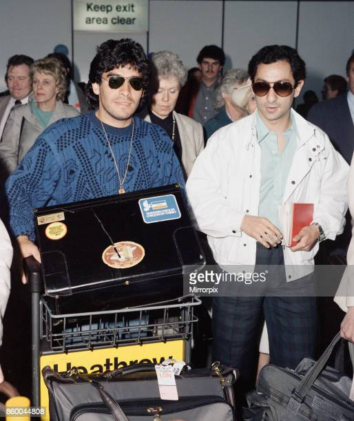 Argentina footballers Diego Maradona is met by his friend and international teammate Osvaldo Ardiles on his arrival at London Heathrow Maradona is...