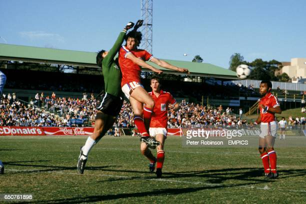 Argentina goalkeeper punches clear from England's Neil Webb watched by England's Stewart Robson and Danny Wallace