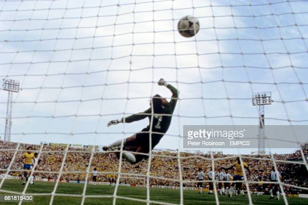 Argentina goalkeeper Ubaldo Fillol is beaten by a freekick which thumped against the bar before being converted by Brazil's Zico for the opening goal