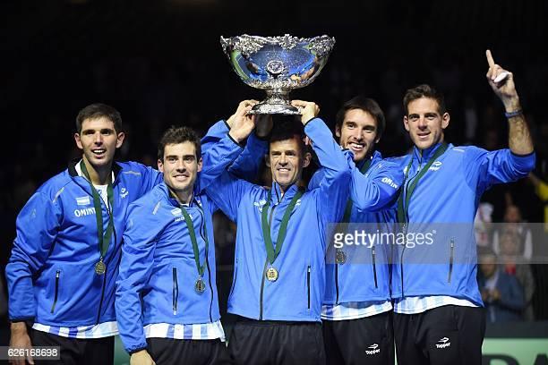 CORRECTION Argentina' Guido Pella Federico Delbonis coach Daniel Orsanic Leonardo Mayer and Juan martin del Potro celebrate with the trophy after...