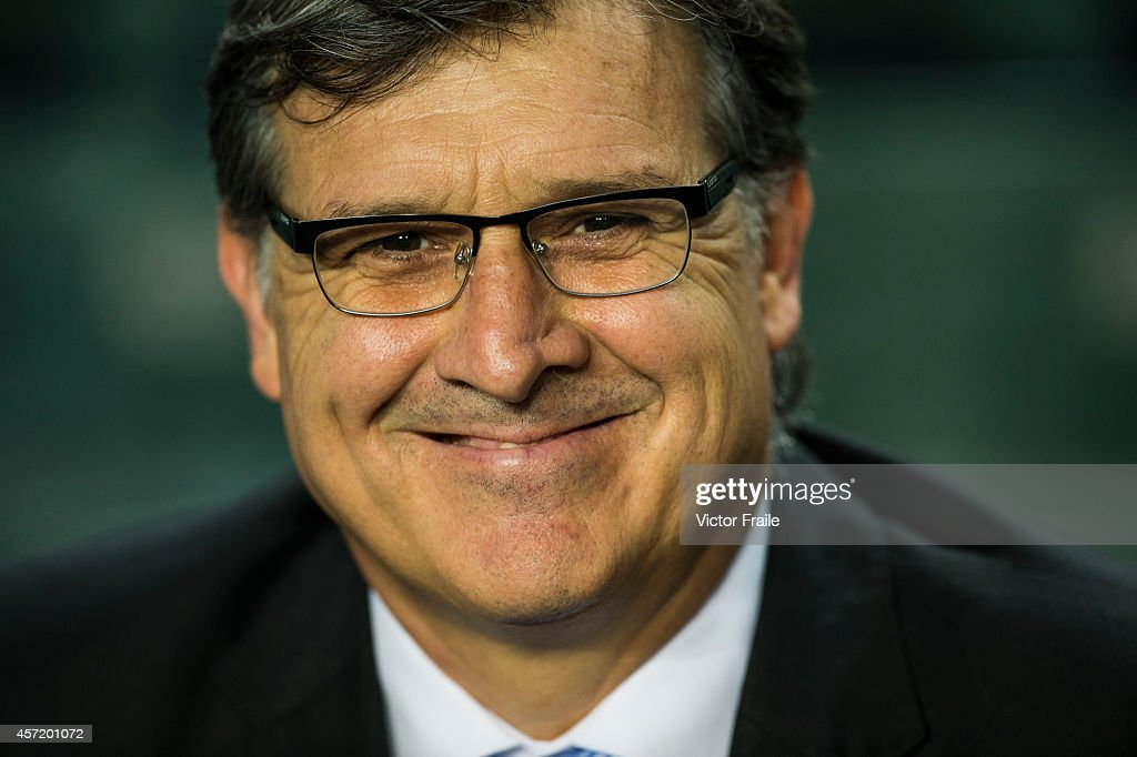 Argentina Head Coach <a gi-track='captionPersonalityLinkClicked' href=/galleries/search?phrase=Gerardo+Martino&family=editorial&specificpeople=4362047 ng-click='$event.stopPropagation()'>Gerardo Martino</a> smiles prior the International Friendly Match between Hong Kong and Argentina at the Hong Kong Stadium on October 14, 2014 in Hong Kong, Hong Kong.