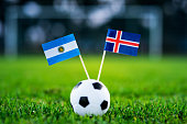 Argentina - Iceland, Group D, Saturday, 16. June, Football, World Cup, Russia 2018, National Flags on green grass, white football ball on ground.