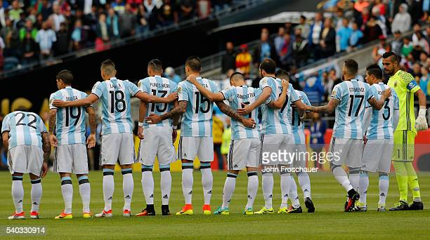 Argentina line up on the field during a minute silence before a Quarterfinal match between Argentina and Bolivia at CenturyLink Field as part of Copa...