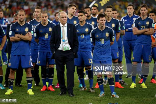 Argentina manager Alenjandro Sabella Argentina's Pablo Zabaleta and Argentina's Lionel Messi appear dejected after the final whistle during the FIFA...