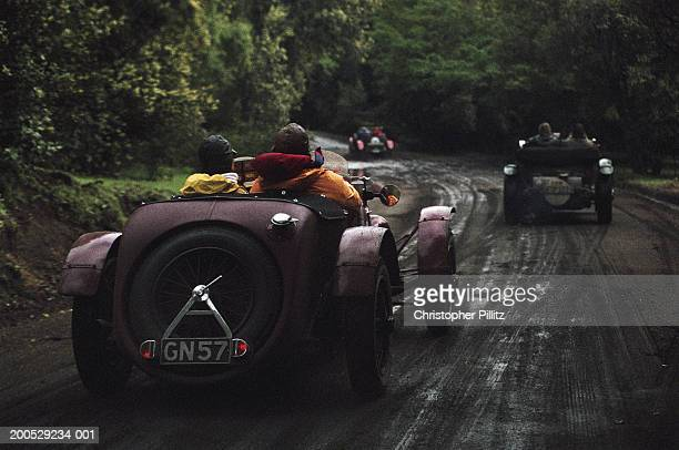 Argentina, Mille Miglia Classic Car Race, race cars on road, rear view