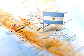 The flag of Argentina pinned on the map. Horizontal orientation. Macro photography.