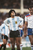 Argentina player Diego Maradona and England player Ray Kennedy look on during an International friendly match at Wembley Stadium on May 13 1980 in...