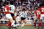 Argentina player Diego Maradona takes on the Belguim defence during the 1982 FIFA World Cup match between Argentina and Belguim at the Nou Camp...