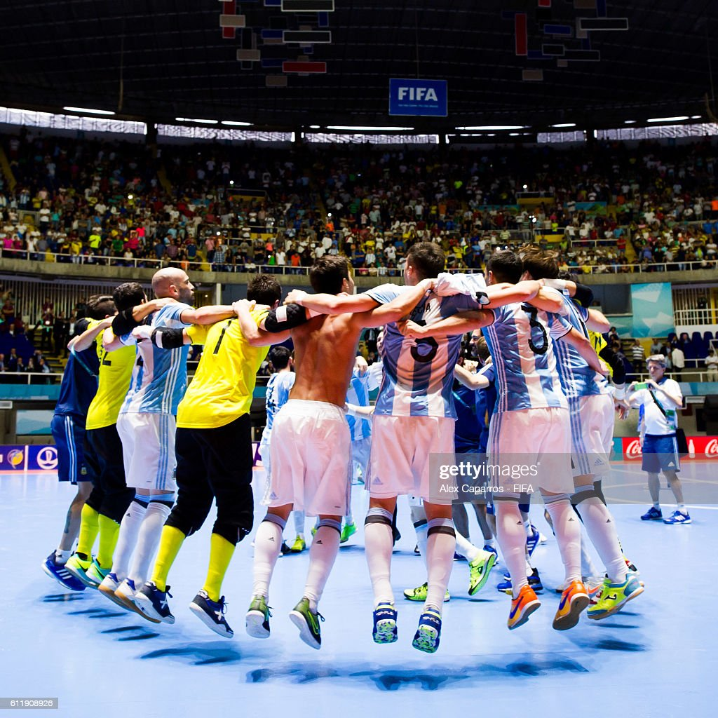 Argentina players celebrate after the victory during the FIFA Futsal World Cup final between Russia and Argentina at Coliseo el Pueblo on October 1, 2016 in Cali, Colombia.