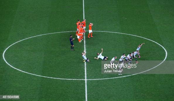 Argentina players celebrate defeating the Netherlands in a shootout during the 2014 FIFA World Cup Brazil Semi Final match between the Netherlands...