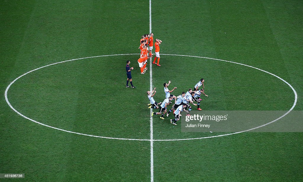 Argentina players celebrate defeating the Netherlands in a shootout during the 2014 FIFA World Cup Brazil Semi Final match between the Netherlands and Argentina at Arena de Sao Paulo on July 9, 2014 in Sao Paulo, Brazil.