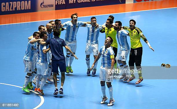 Argentina players celebrate victory at the final whistle during the FIFA Futsal World Cup final between Russia and Argentina at Coliseo el Pueblo on...