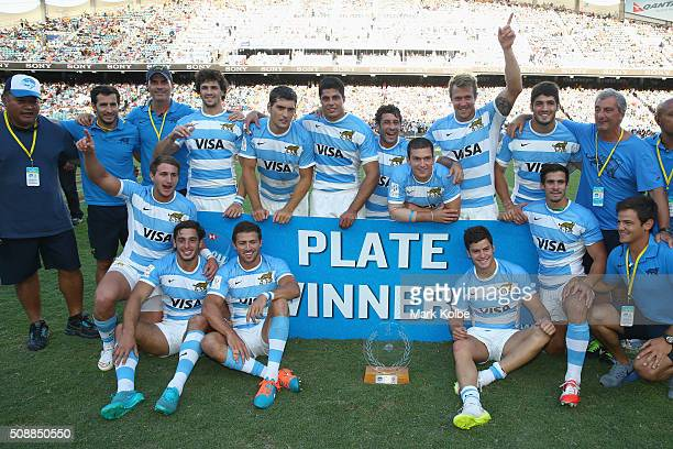 Argentina pose with the trophy after victory during the 2016 Sydney Sevens plate final match between Kenya and Argentina at Allianz Stadium on...
