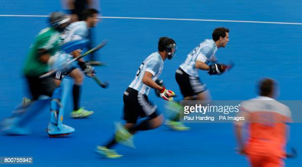 Argentina rush to charge down a penalty corner during the Men's World Hockey League Semi Final Final match at Lee Valley Hockey Centre London PRESS...