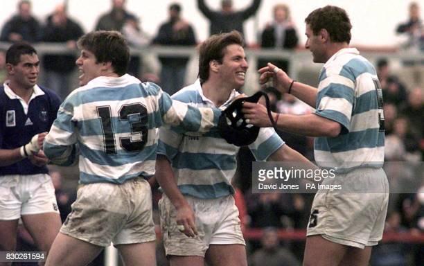 Argentina 's Gozalo Quesada celebrates victory against Samoa with teamates Eduardo Simone and Santiago Phelan in the Rugby World Cup match at Stradey...