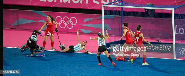 Argentina score a second goal against Great Britain during the second semifinal of the women's field hockey match at the Riverbank Arena in London on...